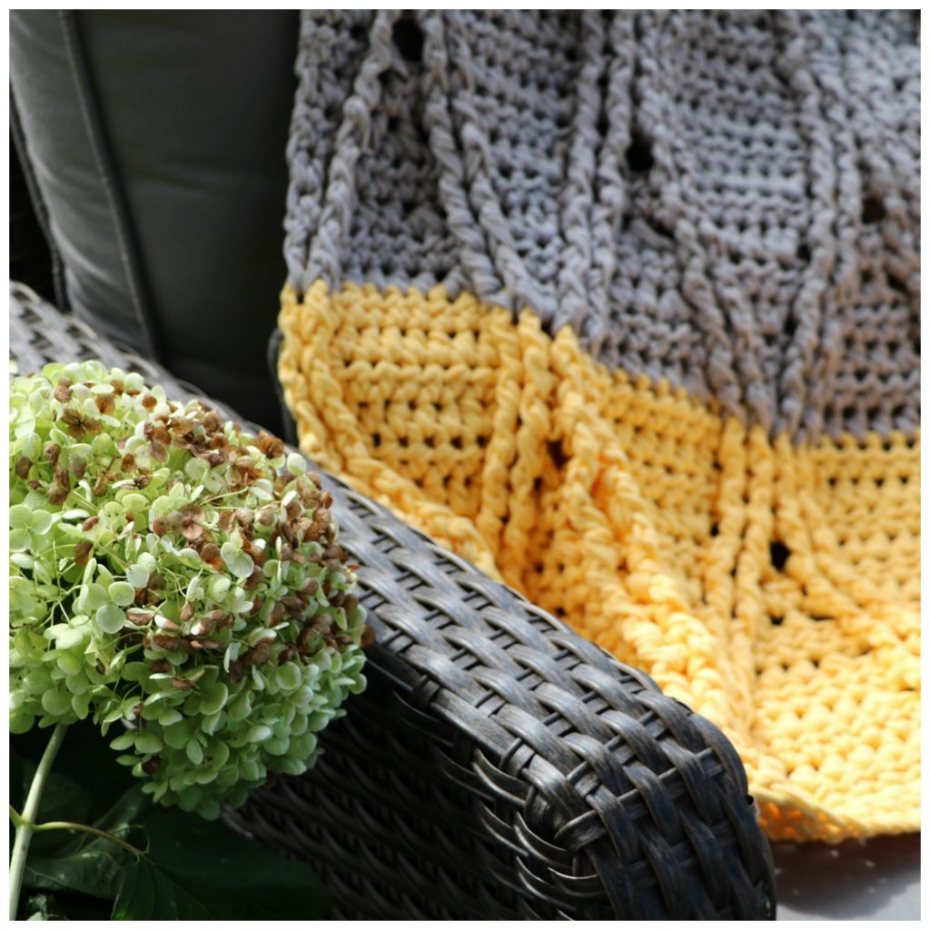 keyhole blanket on patio furniture cozy shot