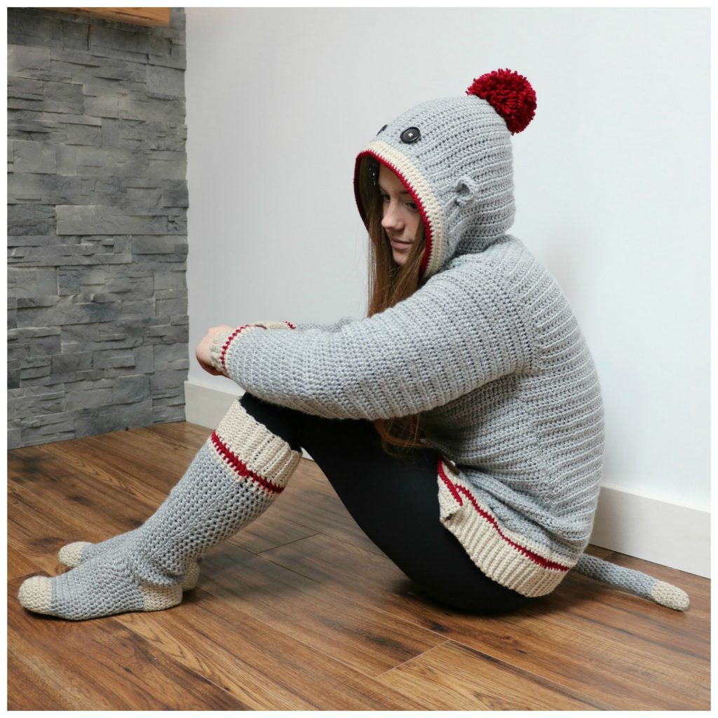 sock monkey adult sitting